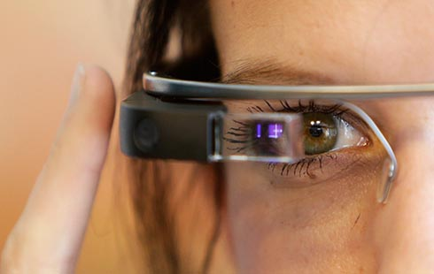A woman wears Google glasses after a media presentation of a Google apartment in Prague